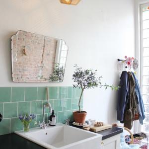 Mirror above kitchen sink