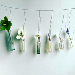 Glass bottles hanging with wire