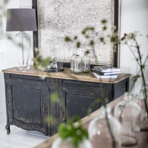 Glass knick-knacks on distressed sideboard