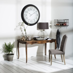 Home office with large wall clock