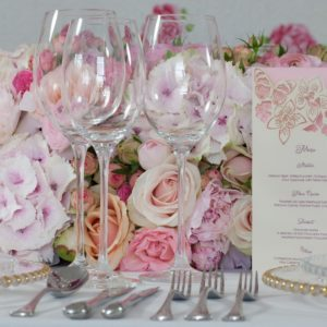 Wine glasses on decorative wedding table with flowers