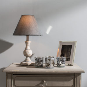 Side table with table lamp and votives