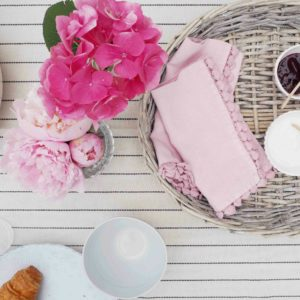 Wicker tray with peonies and breakfast