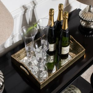 Champagne and flutes on decorative tray