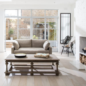 Light and neutral sitting room with coffee table