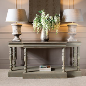 Console table with lamps and large vase flowers