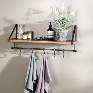 Bathroom shelf with towels and soap