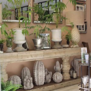 Green plants, stone vases on table at Chelsea Flower Show