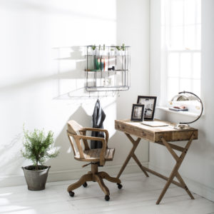 Pine desk with chair, photo frames by a window