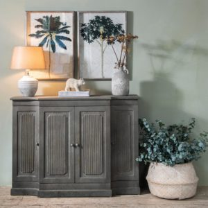 Sideboard with table lamp and botanical prints