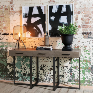 Industrial wall with wall art and side table
